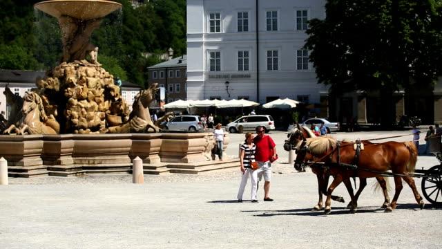 PAN Fiaker Carriage With Tourists Riding On Residenzplatz In Salzburg
