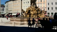 Fiakers Passing the Residenzbrunnen (Residence Fountain) on Residenzplatz (Residence Square) in Salzburg