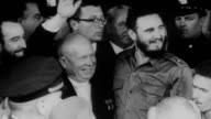 Fidel Castro and Premiere Nikita Khrushchev flaunt friendship as President Eisenhower talks to Pan American leaders / Khrushchev smiles and waves...