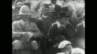 Field Marshal Sir Edmund Allenby sitting in chair next to unidentified male in hat at outdoor gathering Middle East setting c1925