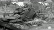 1942 MONTAGE Fields and farm equipment in disarray, with fields overgrown and equipment unused / United Kingdom
