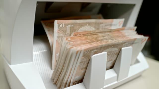 SLO MO LD Fifty euro banknotes shuffling through the money counter