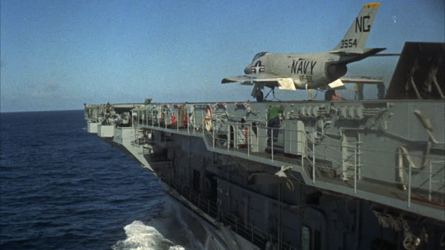 WS Fighter jet on aircraft carrier launching deck