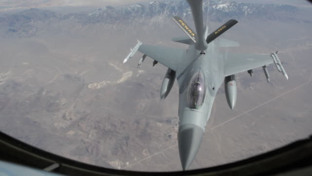 MS F-16 fighter jet refueling in mid-air, Colorado Rockies, Colorado, USA