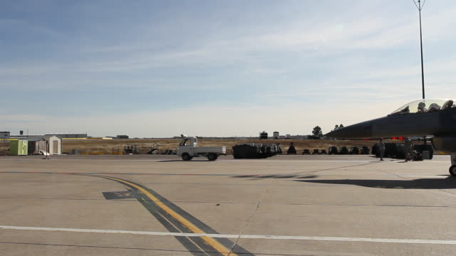 MS F-16 fighter jet taxiing across airfield, Aurora, Colorado, USA