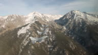 TS 4 F-16 fighter jets flying in formation in front mountains, Colorado Rockies, Colorado, USA