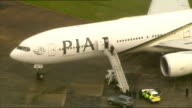 Fighter jets scrambled following incident on PIA passenger aircraft two men arrested Various AERIAL shots PIA plane on tarmac with police officer...