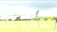 Fighter jets scrambled following incident on PIA passenger aircraft two men arrested More shots of PIA plane on runway with people seen walking up...