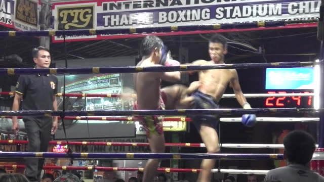 Fighters compete in Muay Thai boxing at Thaphae Boxing Stadium in Chiang Mai