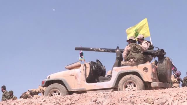 Fighters from the Lebanese Shiite movement Hezbollah were seen manning positions near Syrian troops on Wednesday around the Syrian town of Flita near...