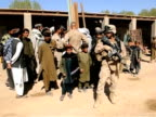 File images show US General Stanley McChrystal head of the NATOled force in Afghanistan during a visit to Marjah in Helmand Province where thousands...
