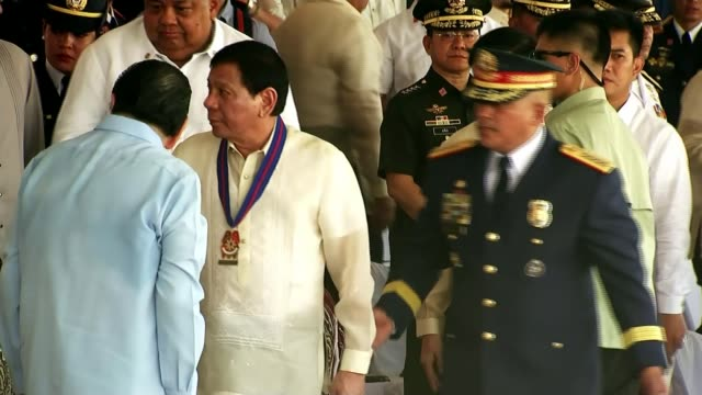 Filipino police kill 32 in one night of operations DAY Rodrigo Duterte along at ceremony Filipino police with riot shields along Various of armed...