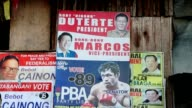 Filipino police kill 32 in one night of operations Manila Duterte and Bongbong Marcos poster