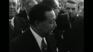 Filipino President Elpidio Quirino as he is addressed by Italian man and as he listens surrounded by dignitaries / CU Quirino and Pan to Ida Einaudi...