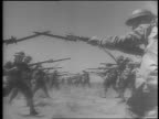 Filipino Soldiers marching and turning / Colonel Robert Sanford Offley and Filipino officer saluting / soldier marching down road / montage of...