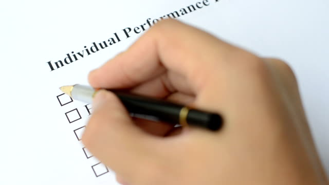 filling employee performance evaluation form