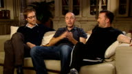 'An Idiot Abroad' interviews ENGLAND London INT From LR Stephen Merchant Karl Pilkington and Ricky Gervais siting on sofa / Pilkington interview SOT...