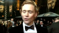 celebrity arrivals Side view Tom Hiddleston speaking to press / Brief shot Tom Hooper along Tom Hiddleston interview SOT On being nominated for a...