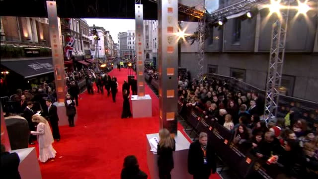 London Royal Opera House EXT High Angle GV of red carpet outside BAFTA venue Gary Oldman chatting