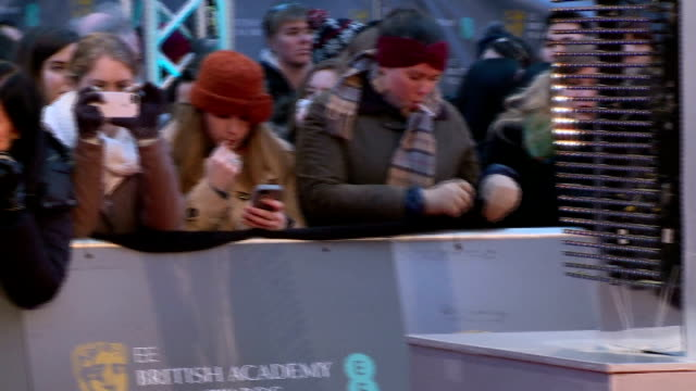 BAFTA Awards 2015 Red carpet arrivals ENGLAND London Royal Opera House EXT Banner 'EE British Academy Film Awards' / fans with banner 'Good Luck...