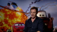 'Cars 2' junket interviews John Lasseter Michael Caine and Jason Isaacs Jason Isaacs interview SOT On two parts in 'Cars 2' Would like to do more...