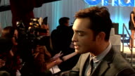 'Chalet Girl' premiere celebrity arrivals Ed Westwick fans laughing / back view of Charlotte Dutton posing / side views of Ed Westwick speaking to...