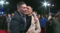 'Creed' Red carpet arrivals Andros Townsend posing for photographs with fans / Tessa Thompson interview SOT / Tony Bellew and James DeGale hugging...