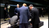 Duke and Duchess of Cambridge and Prince Harry visit Warner Brothers studios EXT William on Batman's motorbike / Harry inspects the bike / Kate...