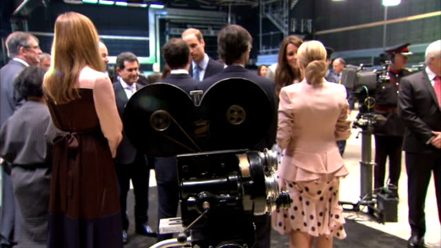 Duke and Duchess of Cambridge and Prince Harry visit Warner Brothers studios highlights Royals wearing dark glasses to watch 3D footage on monitor /...
