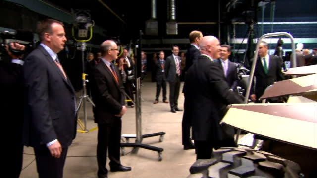 Duke and Duchess of Cambridge and Prince Harry visit Warner Brothers studios highlights William Kate Harry and Warner executives posing for photocall...