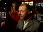 'Hot Fuzz' Red carpet interviews at premiere Simon Pegg interview SOT On the rain / On being a scriptwriter and writing himself dangerous action...