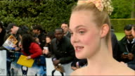 'Maleficent' premiere Celebrity arrivals Elle Fanning speaking to press and interview SOT / Angelina Jolie husband Brad Pitt and their son Maddox...