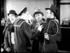 1924 B&W Film montage MS sailor conducting drunks singing in bar/ dog howling along with singing