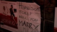 'Morning Glory' premiere celebrity arrivals ENGLAND London Leicester Square Fan with sign reading 'Harrison Ford Will You Marry Me' / TRACKING SHOT...