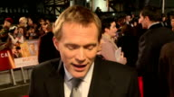 'Mortdecai' premiere Red carpet arrivals Paul Bettany speaking to press and interview SOT / Mark Ronson speaking to press / Only The Young posing /...