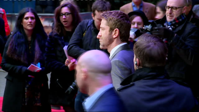 'Olympus Has Fallen' premiere Red carpet arrivals Gerard Butler and Aaron Eckhart posing together / various of Butler speaking to press / Gerard...
