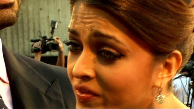 'Raavan' film premiere red carpet arrivals Abhishek Bachchan and Aishwarya Rai red carpet interviews continued SOT/ Amitabh Bachchan red carpet...