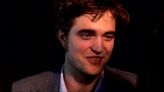 'Remember Me' premiere red carpet arrivals Tom Felton speaking to press / Robert Pattinson speaking to press / Robert Pattinson interview SOT On...