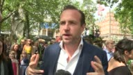 The BFG Premier in Leicester Square **Music heard intermittently SOT** Rafe Spall interview SOT Dame Penelope Wilton chatting to press / Spall...