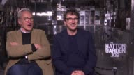 Film 'The Hatton Garden Job' junket interviews and GVs ENGLAND London Hatton Garden INT General views of broken safe boxes / Larry Lamb and Phil...