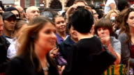 'The Ugly Truth' premiere Sharleen Spiteri posing with fan / Spiteri along on red carpet / Katherine Heigl getting out of car / Heigl along down red...