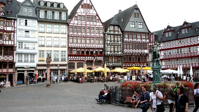 Film Tilt: Pedestrian crowded at Romerberg Town square Frankfurt Germany