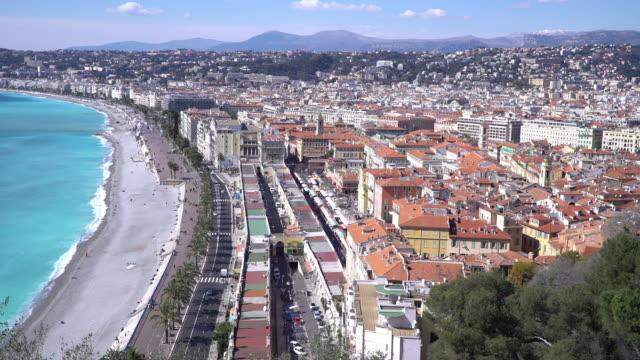 Film Tilt shot of Nice Beach Harbour French Riviera France