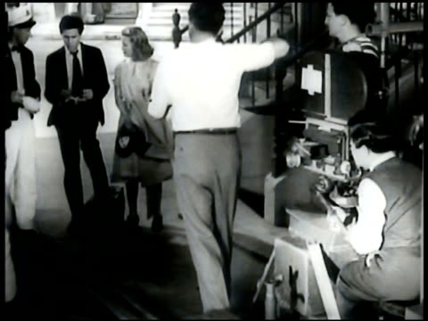 film w/ John Garfield Producer David O Selznick talking w/ two men Sign Set Gone With the Wind GWTW Tara set w/ EXT scorched plantation home filming...