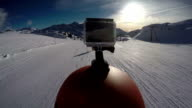 filming action cam on ski helmet while skiing