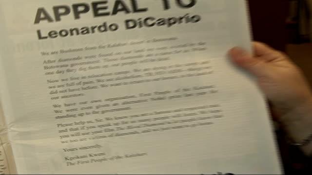 'Blood Diamond' controversy ENGLAND London INT Setup Fiona Watson showing open letter from Kalahari bushmen of Botswana to Leonardo diCaptio in...