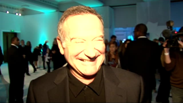 'Happy Feet Two' premiere red carpet interviews Robin Williams interview SOT On being very happy / on not being a good dancer / On beating the winter...