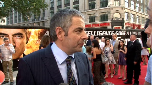 'Johnny English Reborn' premiere Rowan Atkinson talking to the media Rowan Atkinson interview SOT No new pickup lines in this movie didn't know any...