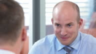 HD: Financial Advisor Talking With His Client