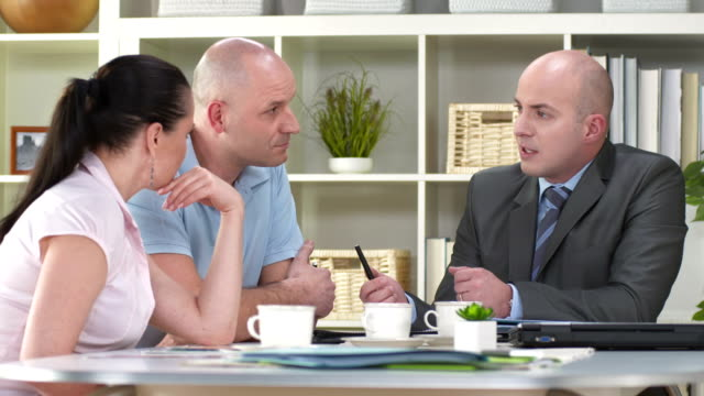 HD: Financial Advisor Talking With His Clients
